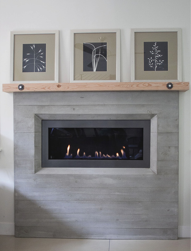 Naturally gray concrete wall fireplace without a base.