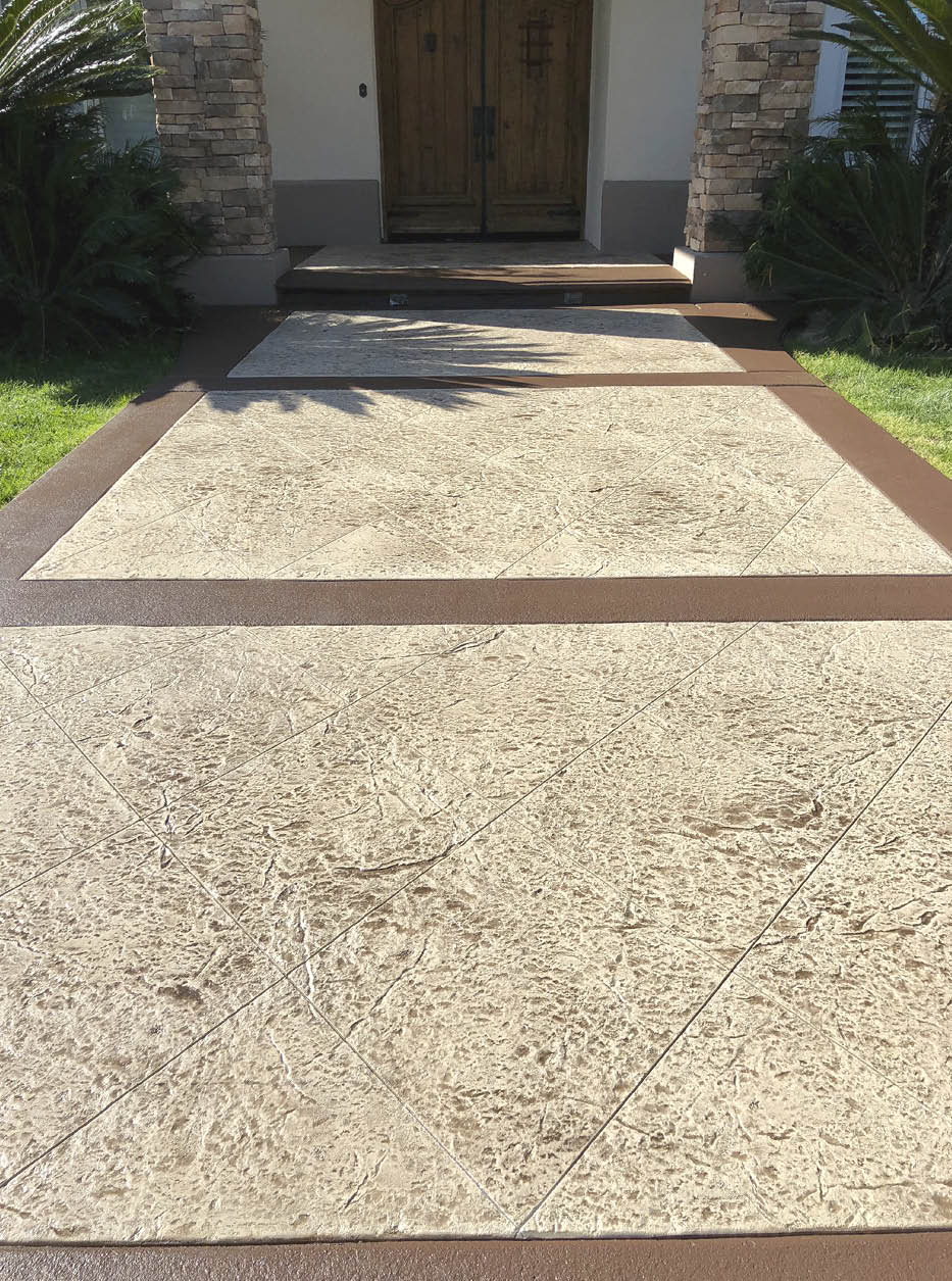 Great contrast using color hardners on this concrete walkway with dark brown bands of smooth concrete.