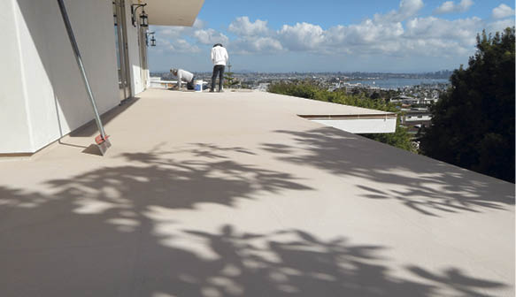 Seen here is a wooden deck in Point Loma, California, before and after Kaimana Coatings installed a decorative waterproofing system over it. Photos courtesy of Kaimana Coatings