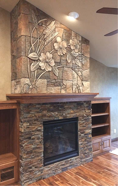 An updated and artistic concrete fireplace.