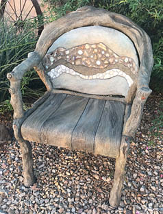 Chair made with concrete and carved to give it a custom look.