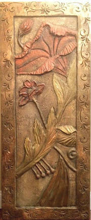 Carved wall panel with hummingbird using bas-relief.