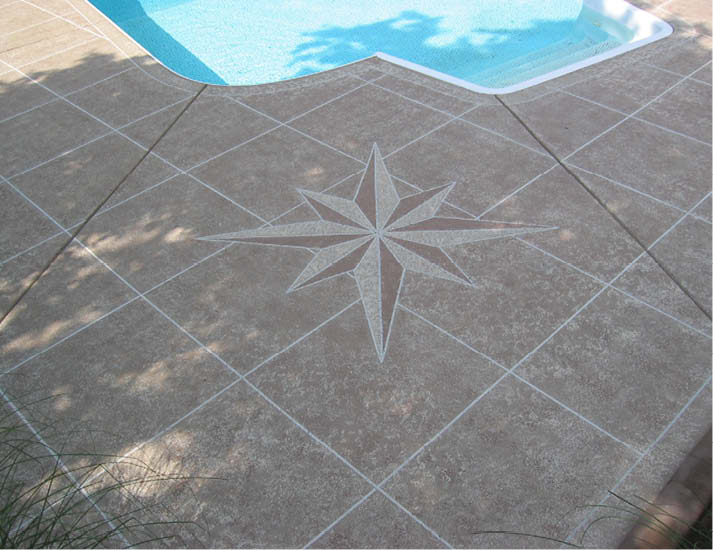 a compass rose has been applied to a pool deck with layers colors.