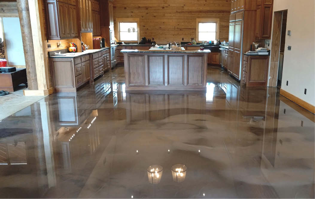 Brown and gray metallic concrete floor in a dining room and kitchen.