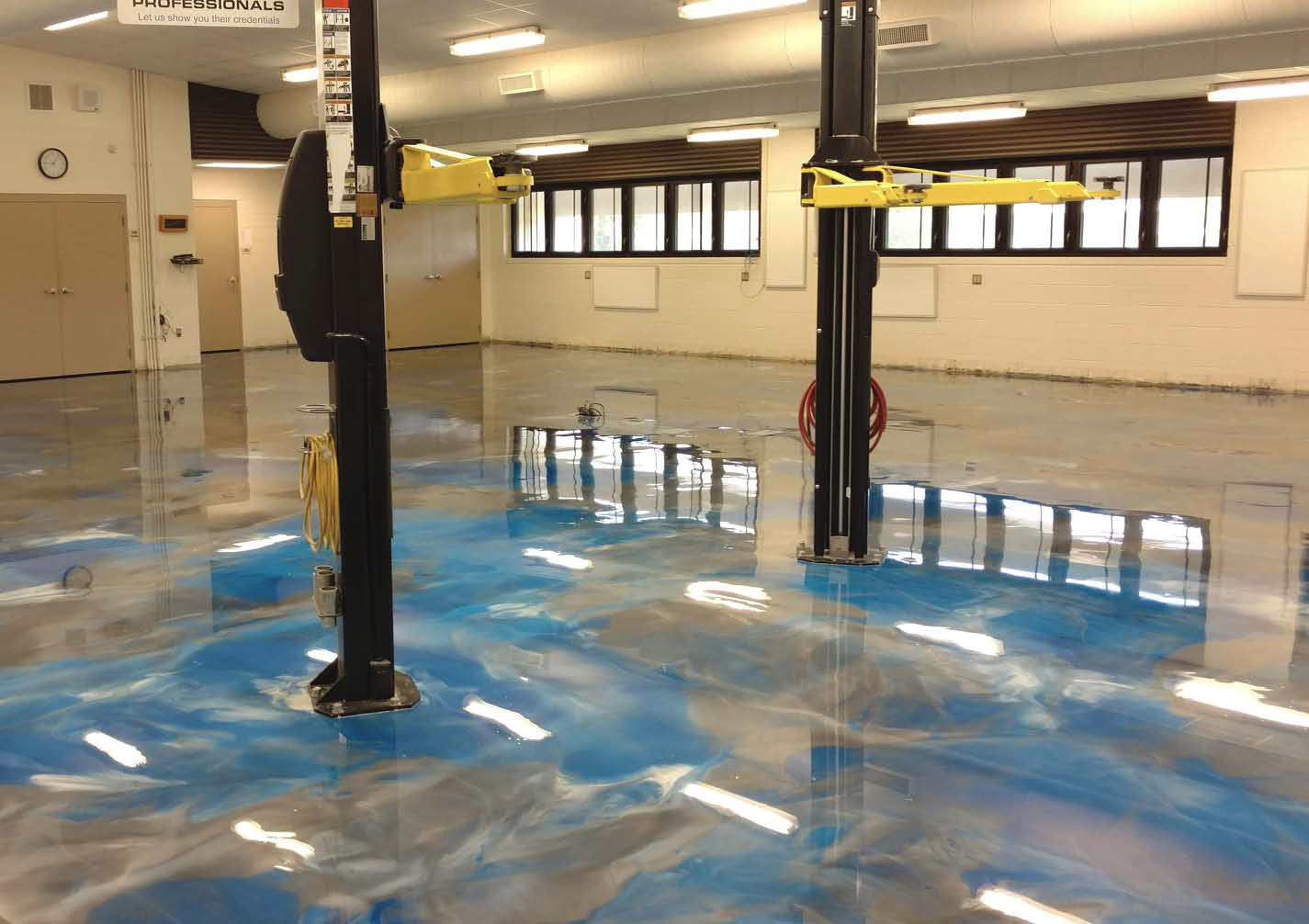 Blue and gray metallic epoxy floor in garage.