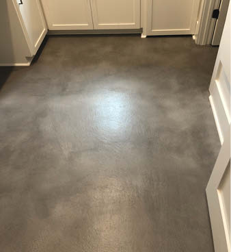 Colored concrete overlay in grays with a hint of red.