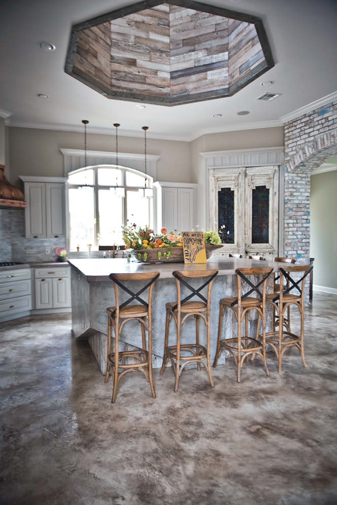 A completely remodeled concrete kitchen in whites, tans and grays.