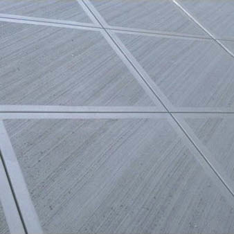 Diagonal control joints on a driveway.