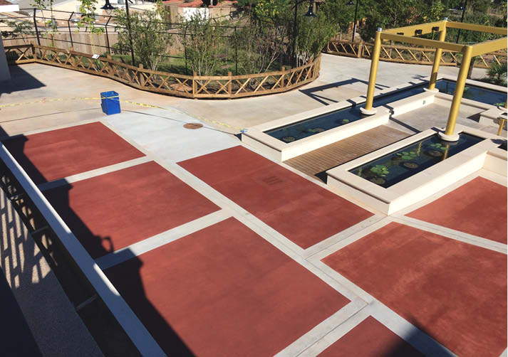 Oklahoma City Zoo officials decided more color was needed to enliven a gray concrete exhibit area. To remedy the situation, Ardor Solutions applied a penetrating opaque stain topped with a water and stain repellent for added protection.