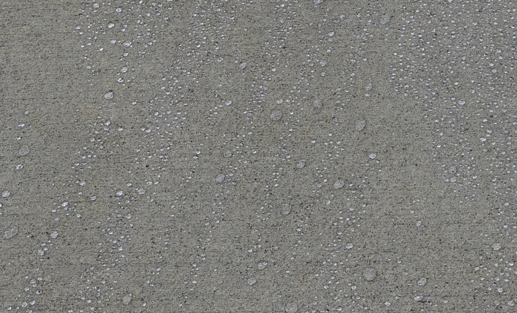 penetrating water-based sealer creating beads on water on concrete