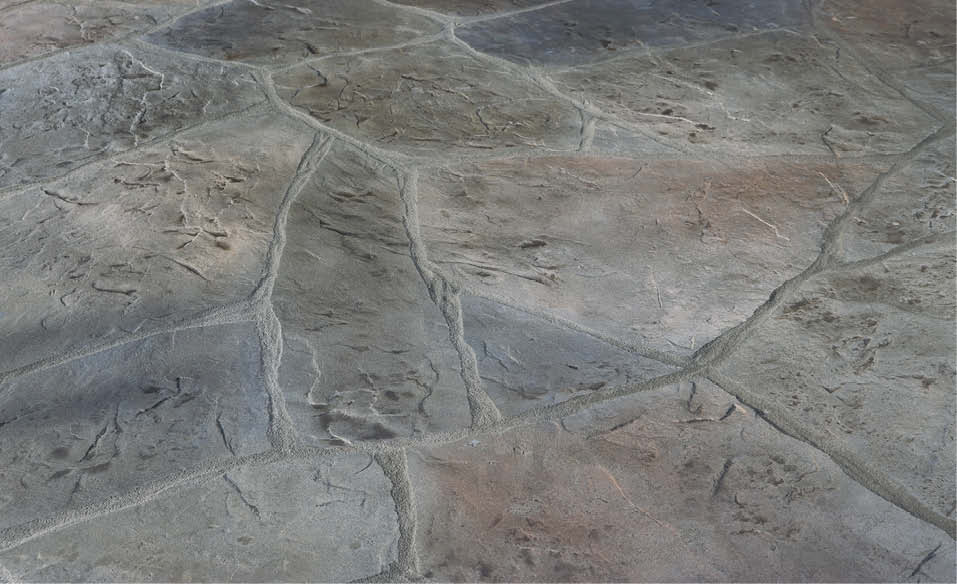 Concrete overlay by Stone Edge Surfaces to create a cobblestone look.