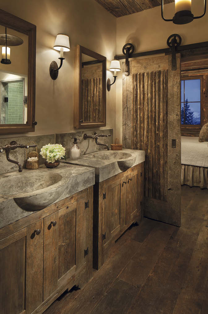 Two matching concrete vanities in a rustic bathroom.