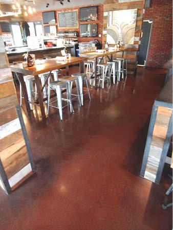 Red concrete floor in a restaurant space.