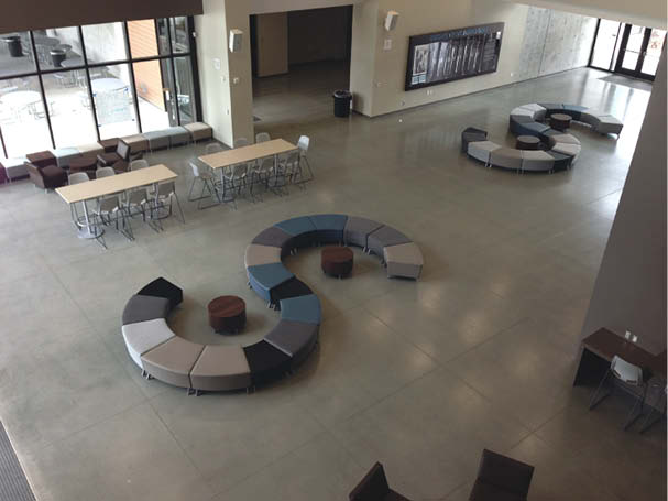Concrete lobby area with polished concrete finish