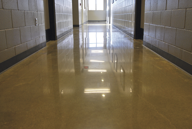 School hallway polished and shiny with a yellow dye.