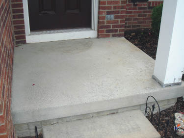 A plain concrete step without any upgraded features.