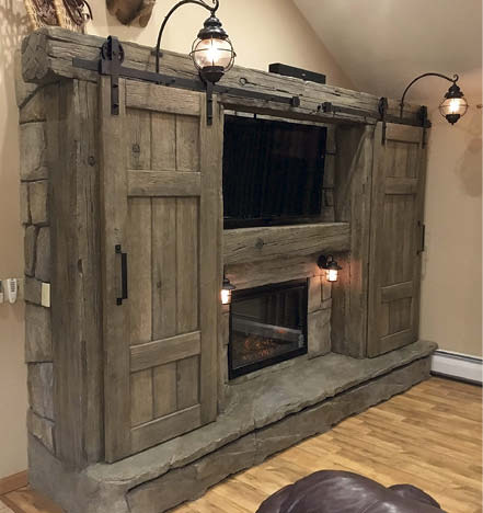 Vertical concrete isn't just being used to replicate a wide variety of stone. This handsome entertainment center may look like reclaimed barn wood, but it's carved concrete. The unit's operable doors are designed to slide back and forth.