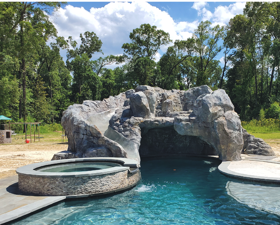 Concrete rock feature with a built in water slide