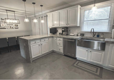 Kingdom Products' Rosalia Microtopping System was used on this kitchen floor and countertop, including the waterfall edge. The color was achieved simply by troweling multiple colors of material together.