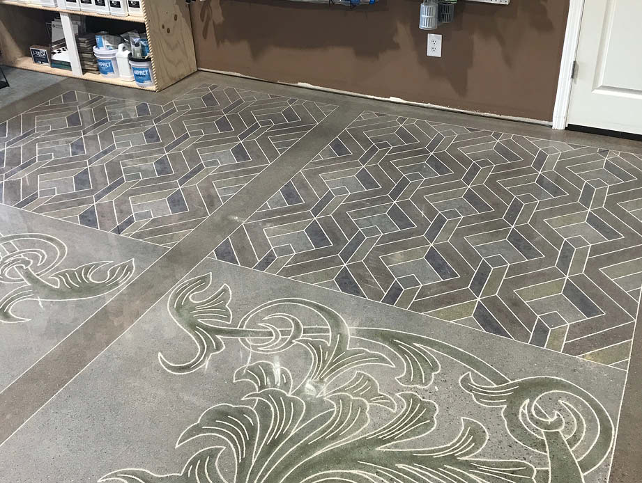 A look at the concrete floor of Decorative Concrete Institute that has been engraved and stained with geometric patterns,