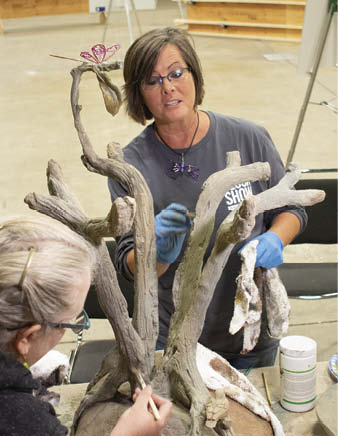 Cindee Lundin leads a workshop where she and show participants make a bird bath that incorporates the art of faux bois, which is French for false wood.