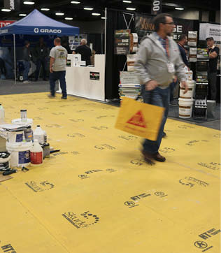 Skudo's HT Commercial System, a high-traffic floor protector used at the show, comprises a nonwoven breathable fabric kept in place with a basecoat.