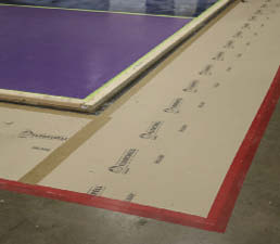 Trimaco FloorShell ProBoard, a heavy-duty yet lightweight surface protector used in the show's workshop zones, is a breathable, reusable, leak- and impact-resistant floor covering made from recycled fibers.