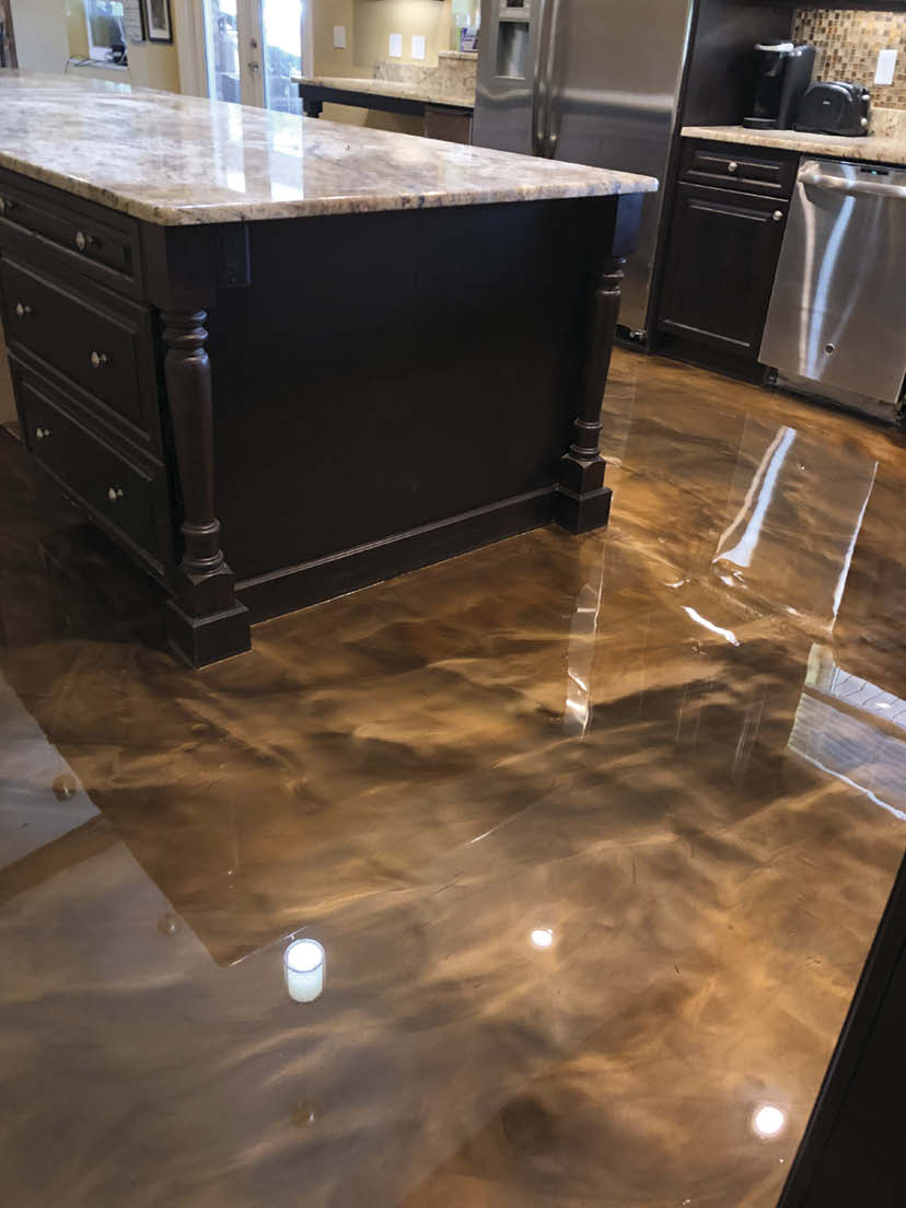 Kitchen floor with black and brown swirling epoxy.