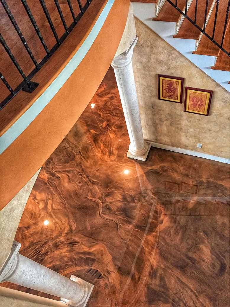 A look down on a floor that has been transformed with brown epoxy floors and faux finished walls.