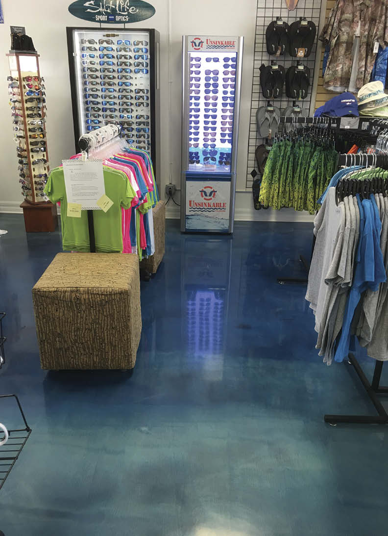 A retail shop with blue epoxy floors.