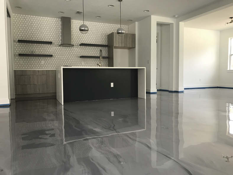 A comfortable kitchen with gray epoxy floor accented with white.