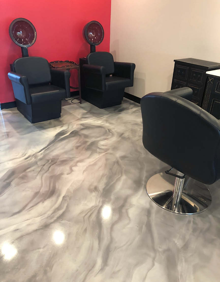 A salon gets a decorative concrete makeover with a new gray and white epoxy floor.