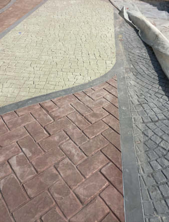 A close up look of concret e textures on the ground in KidZania.
