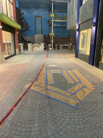 Tape was placed on the ground to ensure that the arrows were properly shaped and formed when painted on the concrete.