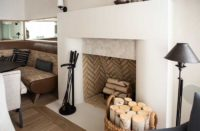 concrete fireplace in all white has pleasing aesthetics
