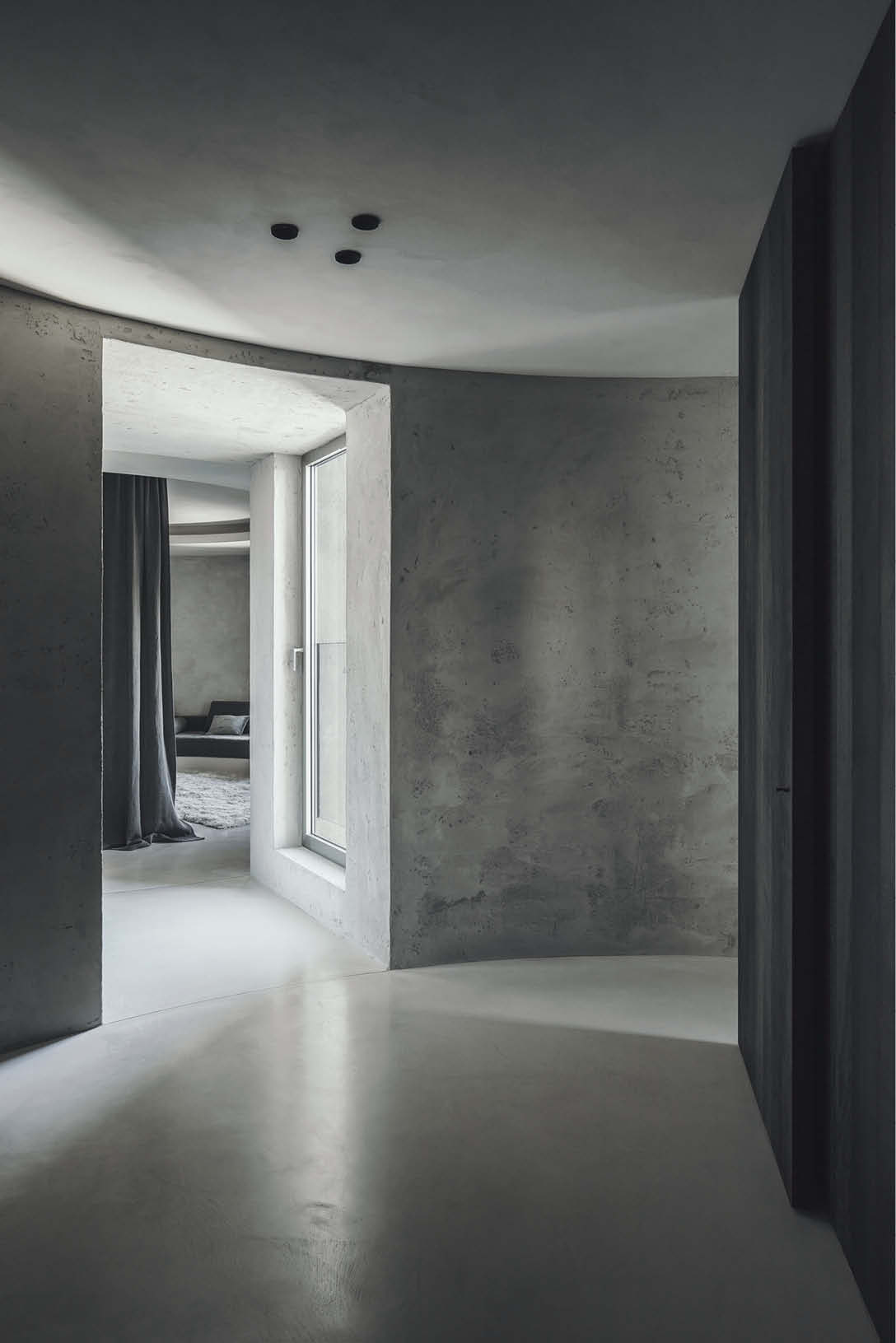 The minimalist look typical of the Microtoppping coating can be seen here in this apartment in Belgium