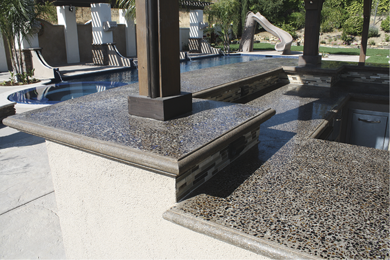 Combining materials — such as glass, colored aggregates, wood and metal in or around concrete — is a current micro-trend for cast-in-place concrete.