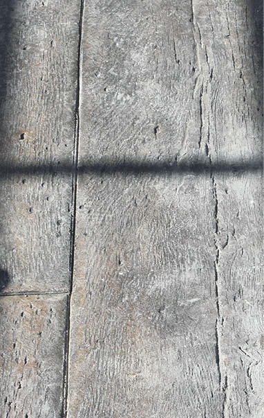 Concrete wood planks stamped and stained to look authentic.