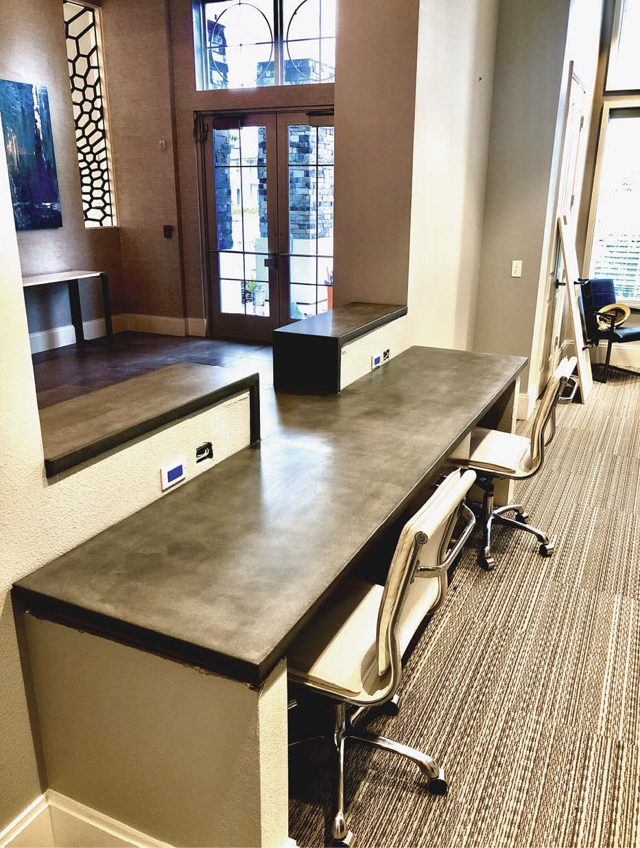 Office space with concrete desk.