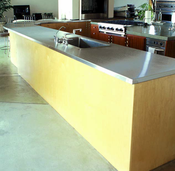 Cast in place concrete countertop on a simple kitchen island.