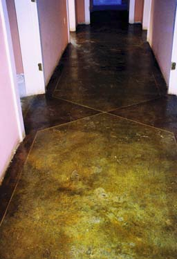 Dark acid-stain hallway that is subject to color fluctuation