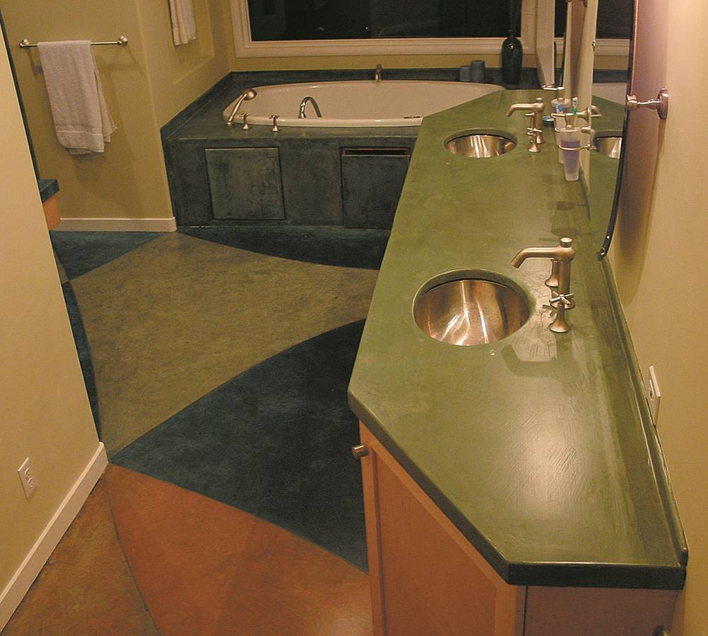 A uniquely shaped green concrete countertop in a bathroom