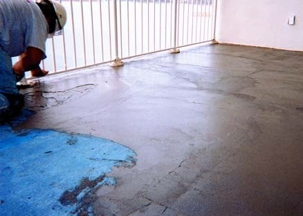 Repairing cracks in the deck or balcony must be done prior to an overlay system.