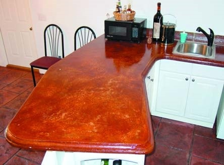Burnt orange cast in place concrete countertop with a marble look