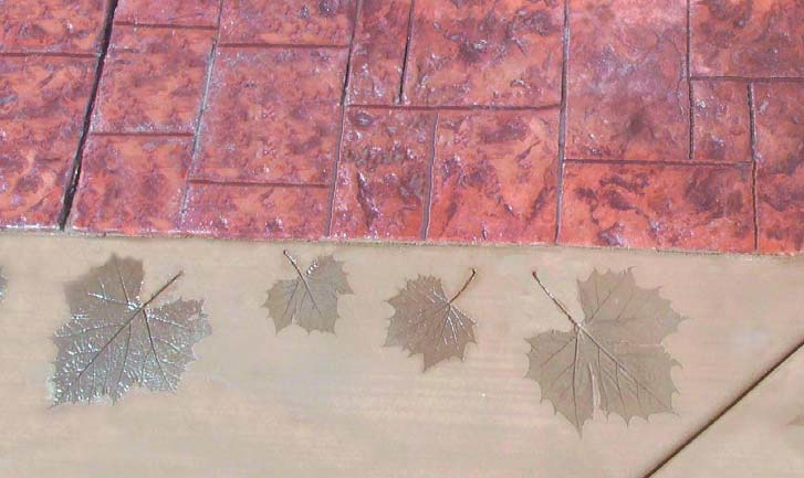 Imprinted concrete leaves create a natural look in this border.