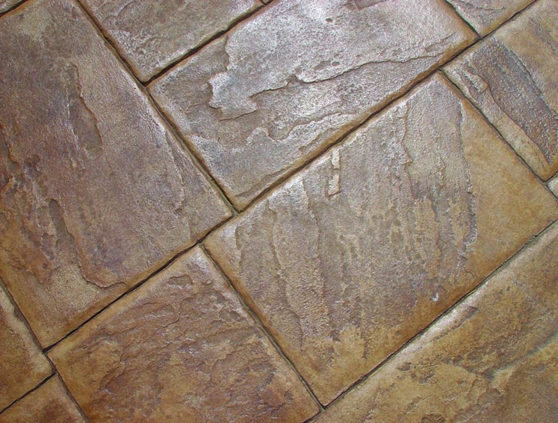 A close up of stamped concrete joints.