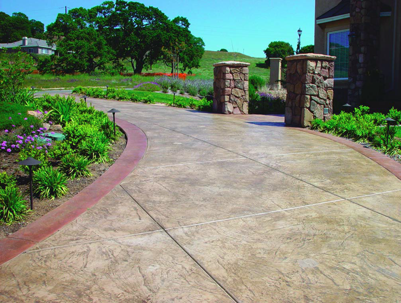 Stamped concrete driveway adds a very sophisticated entrance to home.