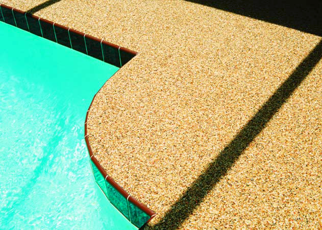 Epoxy pebble systems around a pool deck