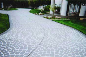 Full shot of a concrete driveway with concrete stencils applied.