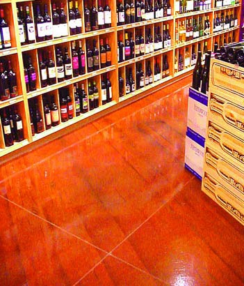 This wine store floor is stained with a bright orange color of concrete stain